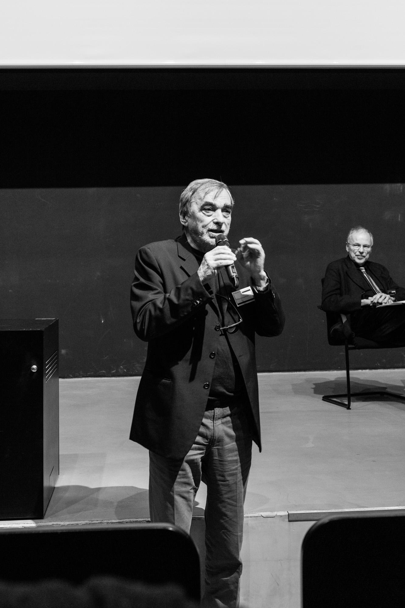Marco De Michelis im Publikum. Fotografen: Samuel Solazzo, Jannis Uffrecht, Philipp Niemeyer